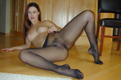 Karlie montana loves playing with her pussy. In only her black Wolford pantyhose Karlie Montana stands over the top of your face and pulls them high and tight against her lascivious little kitty and giggles some more as you begin to sweat. Karlie slides her fingers up and down her kitty.