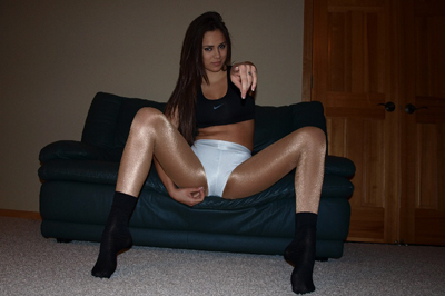 Nina james teases your little penish. Nina James is on your couch wearing skin tight white butt shorts with shimmering nude pantyhose and a tight black top to match her black cotton socks. She looks even better all grown up and she knows what that does to your desperate little cock.